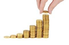 Стог денег в руке изолированной на белой предпосылке Стоковая Фотография RF