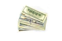 Стог денег на белой предпосылке Доллары Стоковые Фотографии RF