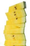 Стог желтых изолированных кусков арбуза на белизне Стоковое Фото