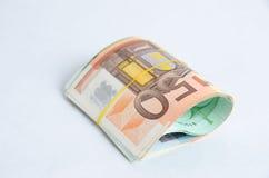 Стог изолированных банкнот евро Стоковые Изображения