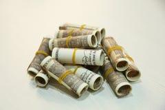 Стог индейца примечание валюты 10 рупий свертывает стоковое изображение