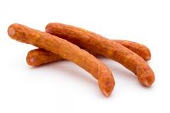 Стог копченых сосисок на белой предпосылке Стоковая Фотография RF