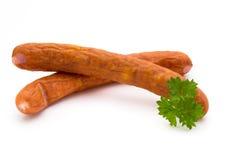 Стог копченых сосисок на белой предпосылке Стоковые Фото