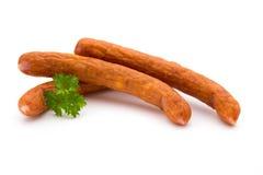 Стог копченых сосисок на белой предпосылке Стоковое Фото