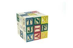 Стог красочных блоков алфавита изолированных на белизне Стоковые Изображения