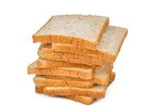 Стог куска хлеба всей пшеницы изолированного на белизне Стоковые Изображения
