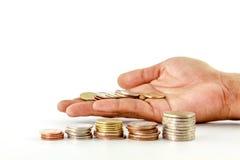Стог монеток в руке Стоковые Фотографии RF
