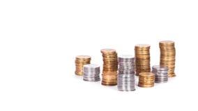 Стог монеток изолированных на белой предпосылке Стоковое Изображение