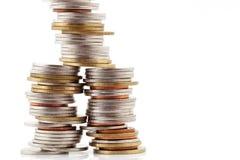 Стог монеток на белой предпосылке, концепции дела Стоковая Фотография RF