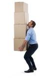 Стог нося мужской исполнительной власти картонных коробок Стоковые Изображения RF