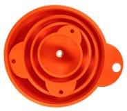 Стог 4 оранжевых пластичных воронок изолированных на белом backgroun Стоковые Фотографии RF
