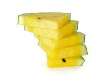 Стог отрезанного желтого арбуза на белизне Стоковое Фото