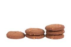 Стог печений масла гайки анакардии шоколада изолированный на задней части белизны Стоковое Изображение