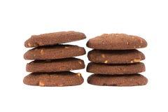 Стог печений масла гайки анакардии шоколада изолированный на задней части белизны Стоковое Изображение RF