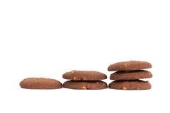 Стог печений масла гайки анакардии шоколада изолированный на задней части белизны Стоковые Фотографии RF