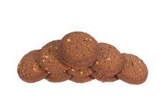 Стог печений масла гайки анакардии шоколада изолированный на задней части белизны Стоковые Изображения
