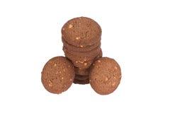 Стог печений масла гайки анакардии шоколада изолированный на задней части белизны Стоковое фото RF