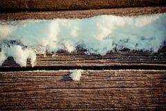 Стог покрытый снегом деревянный Стоковая Фотография