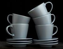 Стог пустых чашек и поддонников эспрессо Стоковые Фотографии RF