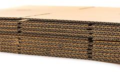 Стог рифлёных картонных коробок вид сбокуый перспективы fl Стоковые Фото
