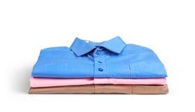 Стог рубашек покрашенных людей Стоковое фото RF