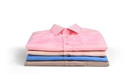 Стог рубашек покрашенных людей Стоковые Изображения