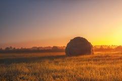 Стог сена на зоре Стоковая Фотография