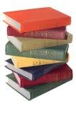 Стог старых книг изолировал белизну Стоковые Фото