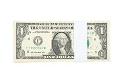 Стог счетов одной деньг доллара США изолированных на белой предпосылке Стоковое Фото