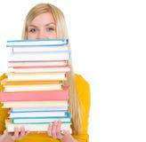 Стог удерживания девушки студента книг Стоковая Фотография