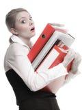 Стог удерживания бизнес-леди документов папок Стоковые Изображения RF