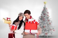 Стог удерживания пар подарков рождества Стоковое Изображение