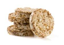 Стог crispbreads зерна на белой предпосылке Стоковое Изображение