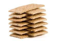 Стог crispbreads зерна на белой предпосылке Стоковая Фотография
