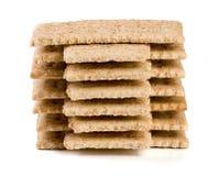 Стог crispbreads зерна на белой предпосылке Стоковые Изображения