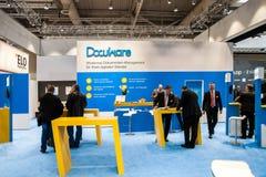 Стойка компании DocuWare на выставке справедливом ceBIT 2017 в Ганновере Messe, Германии DocuWare разработчик  Стоковое Изображение RF