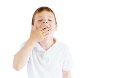 Стойка мальчика на белой предпосылке Стоковые Изображения RF