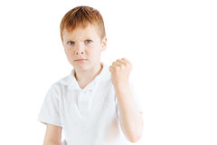Стойка мальчика на белой предпосылке Стоковые Фото