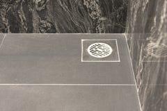 Сток пола в ванной комнате Стоковая Фотография
