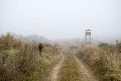 Сторожевая башня в тумане Стоковое Изображение