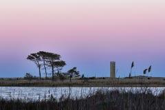 Сторожевая башня на заходе солнца в пляже Rehoboth Стоковые Изображения RF