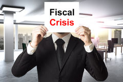 Сторона бизнесмена пряча за кризисом знака фискальным Стоковая Фотография