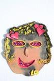 Сторона глины усмехаясь девушки с сердцами Стоковое фото RF