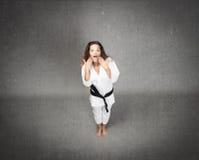 Сторона девушки дзюдо невероятная стоковые фото