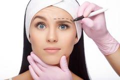 Сторона женщины пластической хирургии Стоковое фото RF