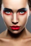Сторона женщины состава красоты крупного плана творческая стоковое изображение