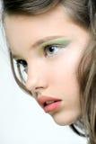 Сторона маленькой девочки с ярким составом на глазах Стоковое фото RF