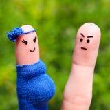 Сторона покрашенная на пальцах Человек был расстроен потому что женщина беременна Стоковая Фотография RF