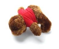 Сторона плюшевого медвежонка лежа вниз Стоковые Изображения