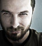 сторона смотря злостую усмешку человека Стоковые Изображения RF